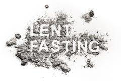在灰、沙子或者尘土写的Lent斋戒的词 免版税图库摄影