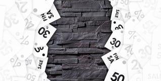 在灰色墙壁纹理的折扣优惠券  免版税库存图片