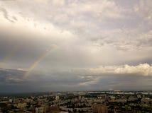 在灰色天空的两条多彩多姿的彩虹 库存照片
