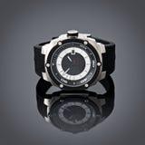 在灰色小插图背景的瑞士人手表 产品摄影 免版税图库摄影