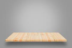在灰色梯度背景的空的木架子 库存图片