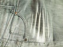 在灰色牛仔裤的口袋 库存照片