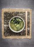 在灰色的大酱汤在灰色石背景 库存照片