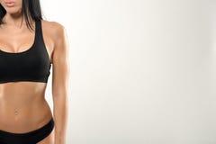 在灰色的美好的健身模型 免版税库存照片