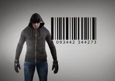 在灰色背景前面的黑客与计算机条码 库存照片
