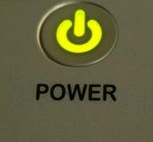 绿灯作为背景的力量按钮 库存图片