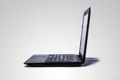 在灰色背景的一台计算机。 免版税库存照片