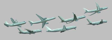 在灰色背景的不同的飞机 库存图片