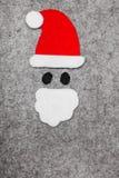 在灰色背景的圣诞老人形状 库存图片