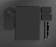 在灰色背景的空白的文具 包括名片, 免版税库存照片