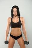 在灰色背景的美好的健身模型 免版税库存照片