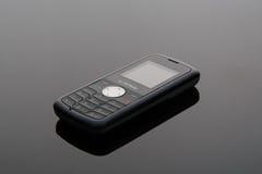 在灰色背景的老手机 免版税库存图片