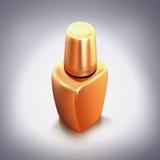 在灰色背景的金黄指甲油 免版税库存图片