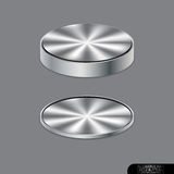 在灰色背景的铝圈子按钮 库存照片