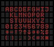 在灰色背景LED数字式字体字母表和数字的红色 库存照片