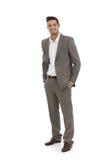 在灰色衣服的英俊的商人 图库摄影