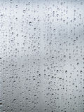在灰色钢的许多小雨下落 免版税库存图片