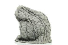 在灰色颜色的太大的童帽 免版税库存图片