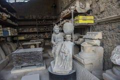在灰被埋没出土的人的图的庞贝城再生产 免版税库存照片