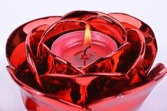 在烛台的红色蜡烛在白色背景 免版税图库摄影