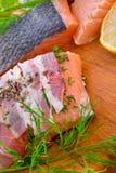 在烟肉外套的三文鱼 图库摄影