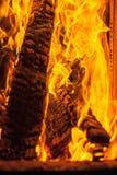 在烤箱的灼烧的木头 库存照片