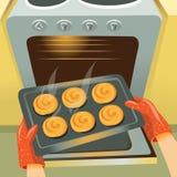 在烤箱的烘烤小圆面包 库存例证