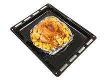在烤箱整鸡的烘烤 免版税图库摄影