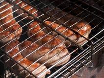 在烤肉的香肠 库存图片