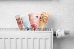 在热化电池的金钱 免版税库存照片