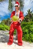 在热带棕榈下的圣诞老人 免版税库存照片