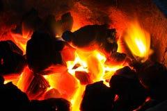 在热炉的灼烧的木头 库存图片