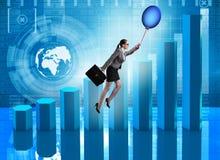 在热的气球的女实业家飞行在图表 免版税库存图片