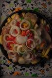在烹调盘子的五颜六色的菜 库存图片