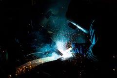 在焊工的配合 库存图片