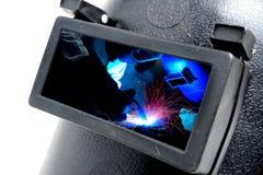 在焊接屏蔽的焊工 免版税图库摄影