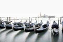 在焦点威尼斯外面的长平底船 图库摄影