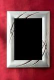 在照片红色丝绸银的框架 免版税库存照片