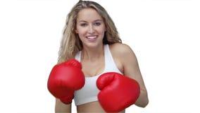 在照相机的妇女拳击 免版税库存照片