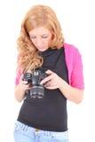 在照相机的少妇注意的照片 免版税库存照片
