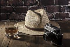 在照相机附近的帽子 库存图片