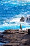 在熔岩海滩的夏威夷fishman 免版税库存照片