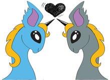在爱动画片的两只独角兽 库存照片
