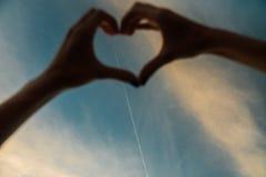 在爱心脏形状的手  免版税图库摄影