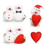 在爱拥抱的两个逗人喜爱的雪人 免版税库存照片
