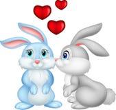 在爱的两个逗人喜爱的动画片兔宝宝 免版税图库摄影