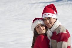 在爱的圣诞节夫妇 免版税图库摄影