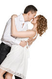 在爱的愉快的微笑的夫妇。隔绝在白色 图库摄影