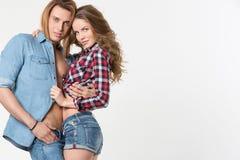 在爱的美好的性感的夫妇在白色背景 免版税库存图片