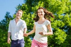 在爱赛跑的夫妇 免版税库存照片